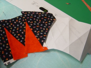 "Flip the project over to check on the ""good"" side and congratulate yourself. If you find the freezer paper is not sticking to the first patches, go ahead and add some pins to keep it in place. After you have all your patches added and ironed, then you can trim the outside cutting line and add the background pieces. I'll post the PDF for this project on Wednesday for you to practice."