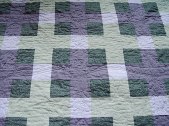 Maple leaf and seeds FMQ design for a queen sized quilt